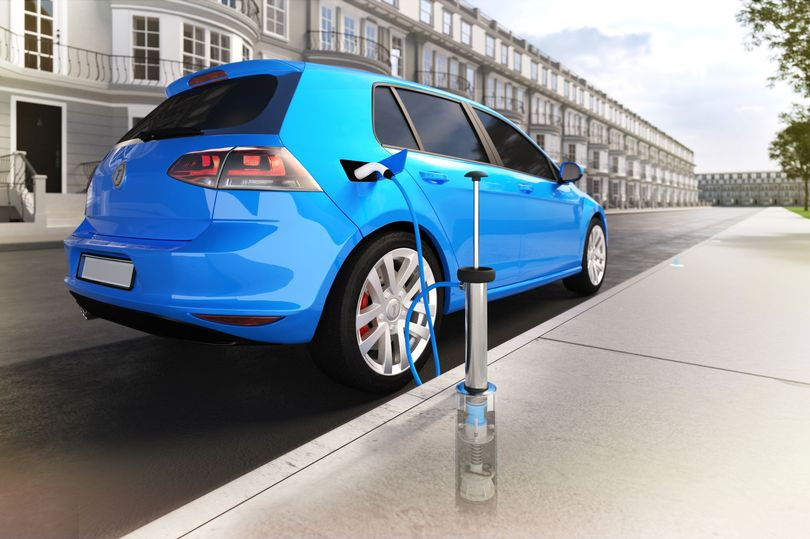 Illustration shows how driver's 'lance' plugs in to charging point embedded in pavement